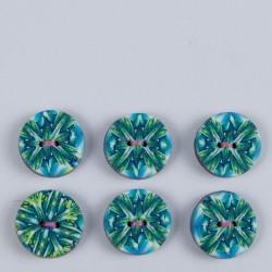 bouton, motif kaléidoscope, motif original dans les tons bleu, vert et jaune